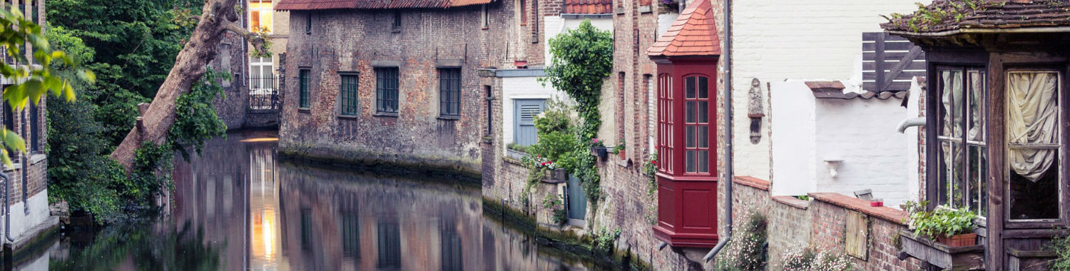 Traditional Flemish houses along the charming canals of Bruges