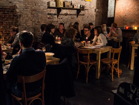 People enjoying their food in a candlelight atmosphere of a cozy restaurant