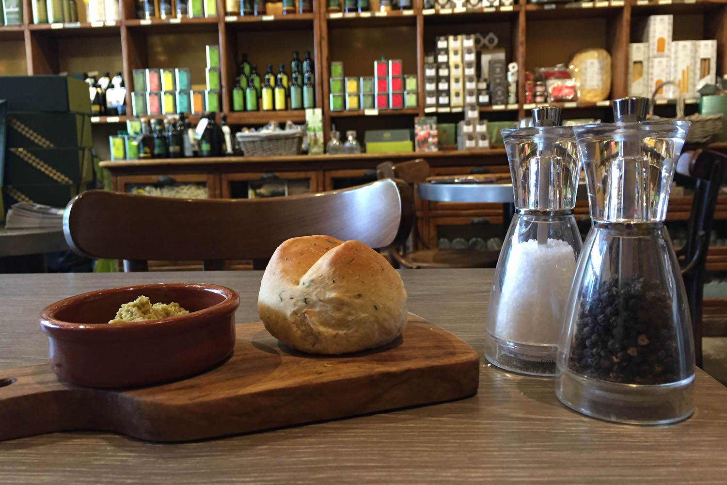 A piece of bread with tapenade in a Mediterranean restaurant